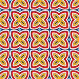 Bright ethnic abstract background. Seamless pattern with symmetric geometric ornament. Stock Image
