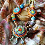 Bright ethnic knitted medallion stock images