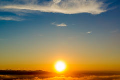Bright evening sun. Goes over the mountains royalty free stock image