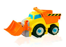 Bright excavator toy car. Isolated track. Stock Photos