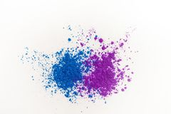 Bright eye shadows in different blue tones, scattered on a white background. royalty free stock image