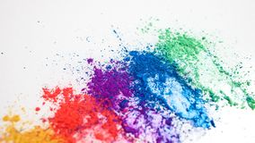 Bright eye shadows in different colors of the rainbow, scattered on a white background. royalty free stock images