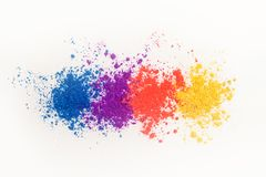 Bright eye shadows in different colors of the rainbow, scattered on a white background. royalty free stock photo