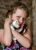 Bright eyed girl with kitten Royalty Free Stock Photography