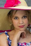 Bright-eyed Girl/Sunhat. Young and beautiful girl with huge eyes posing with huge sunhat Stock Photography