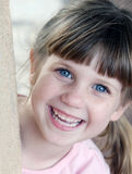 Bright eyes. Smiling young girl with bright blue eyes stock photos