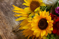 Bright fall bouquet. With sunflowers on wooden background royalty free stock photo