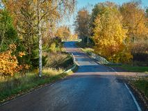 Bright fall colors and beautiful autumn country road in Finland.  stock photo