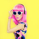 Bright fashion girl music style. On a yellow background Royalty Free Stock Photo
