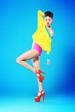 Bright fashion. Glamorous fashion model alluring in vivid colourful clothes and high heels platform shoes. Bright fashion. Full length portrait. Studio shot Royalty Free Stock Images