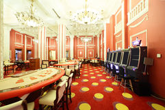 Bright and fashionable casino with tables Royalty Free Stock Photos