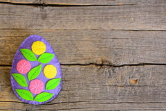 Bright felt Easter egg with flowers  on wooden background with empty place for text Royalty Free Stock Photography