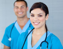 Bright female doctor looking at the camera Stock Photos