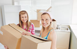 Bright female friends holding boxes Stock Images