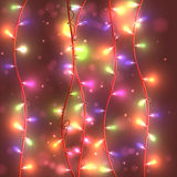 Bright festive background with garlands, lights burning,. Vector Stock Image