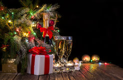Bright festive background with lights and champagne. Copy space Royalty Free Stock Images