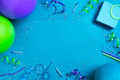 Bright festive blue background with birthday party accessories royalty free stock images