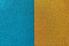 Bright festive brilliant background, consisting of two halves, blue and gold. Horizontal. Copy space for text. royalty free stock images