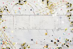 Bright festive carnival background with hats, streamers, confetti and balloons on white background. Bright festive carnival background with hats, streamers royalty free stock image