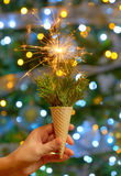 Bright festive Christmas sparkler. In ice cream waffle Royalty Free Stock Images