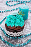 Bright, festive cupcake, candle and macaroon Royalty Free Stock Images