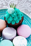 Bright festive cupcake, and macaroons Royalty Free Stock Photos