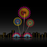 Bright festive fireworks with modern city skyscrapers. At night background Stock Photos