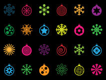 Bright festive icons. Collection of bright snowflake and bauble christmas icons on black Stock Photography