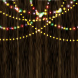 Bright festive lights in the background of varnished wooden surface illustration. Bright festive lights in the background of varnished wooden surface. Vector Royalty Free Stock Images