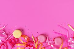 Bright festive pink background with birthday party accessories royalty free stock photo