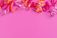 Bright festive pink background with streamers royalty free stock photos