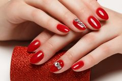 Bright festive red manicure stock photo
