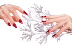 Bright festive red manicure on female hands. Nails design stock images