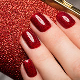 Bright festive red manicure on female hands. Nails design.  Royalty Free Stock Image