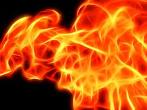 A bright fiery flame on a black background in neon light. Closeup Royalty Free Stock Images
