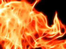 A bright fiery flame on a black background in neon light. Closeup Stock Photos
