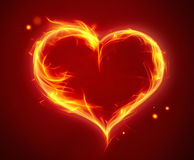 Bright fiery heart. On a red background Stock Image