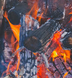 A bright fire and coals closeup Royalty Free Stock Photo