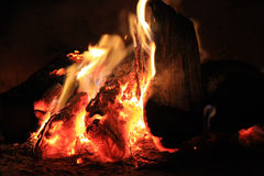 Bright fire in the fireplace. Burning wood photographed close Stock Photos