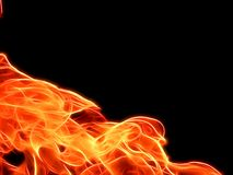 Bright fire flame on a black background in neon color. Close-up Stock Photos