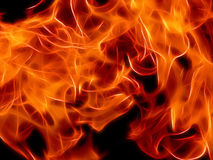 Bright fire flame on a black background in neon color. Close-up Royalty Free Stock Image
