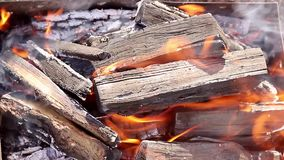 Bright fire smoke and firewood close up. Warm fireplace with lots of trees ready for barbecue. stock video