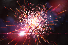 Bright firework design on black Stock Photos