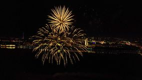 Bright fireworks in honor of the festival above the river stock footage