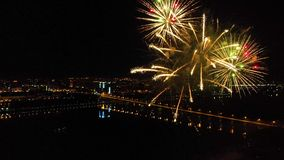 Bright fireworks in honor of the festival above the river stock video