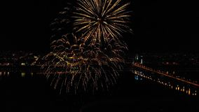 Bright fireworks in honor of the festival above the river stock video footage