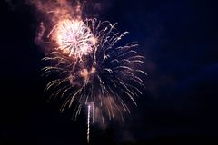 Bright fireworks in the night sky royalty free stock photography