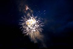 Bright fireworks in the night sky stock photography