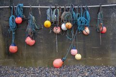 Fishing Buoys  Hung From Harbour Wall Stock Images