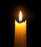 Bright flame of a candle in the dark Royalty Free Stock Images